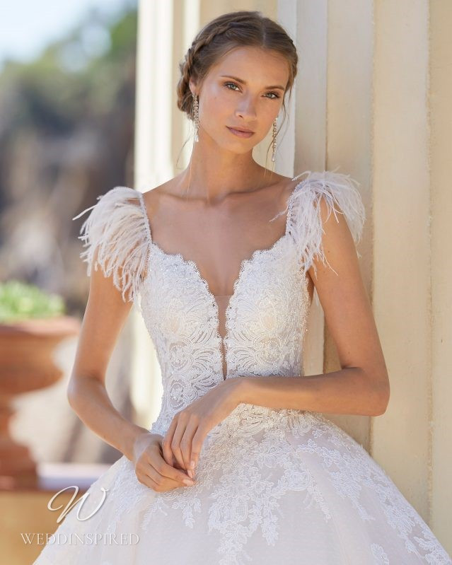 A Rosa Clara 2021 lace princess ball gown wedding dress with feathers