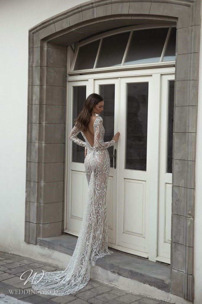 An Eden Aharon 2020 sparkly mesh mermaid fit and flare wedding dress with long sleeves, a v neckline and a low back