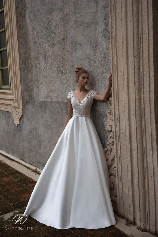 A Naviblue silk satin A-line wedding dress with cap sleeves