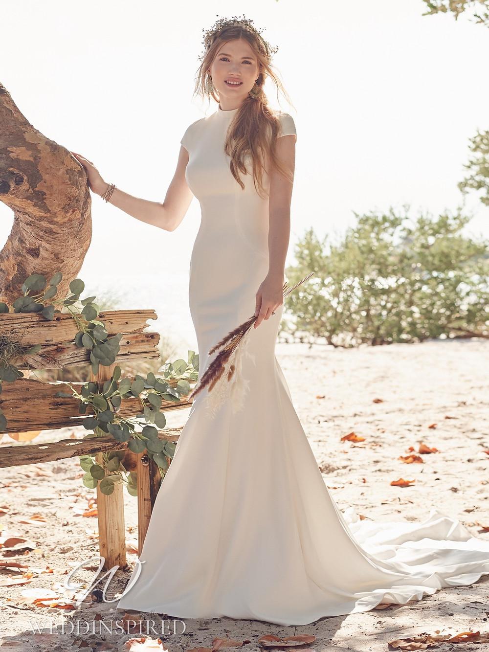 A Rebecca Ingram 2021 simple modest satin mermaid wedding dress with cap sleeves