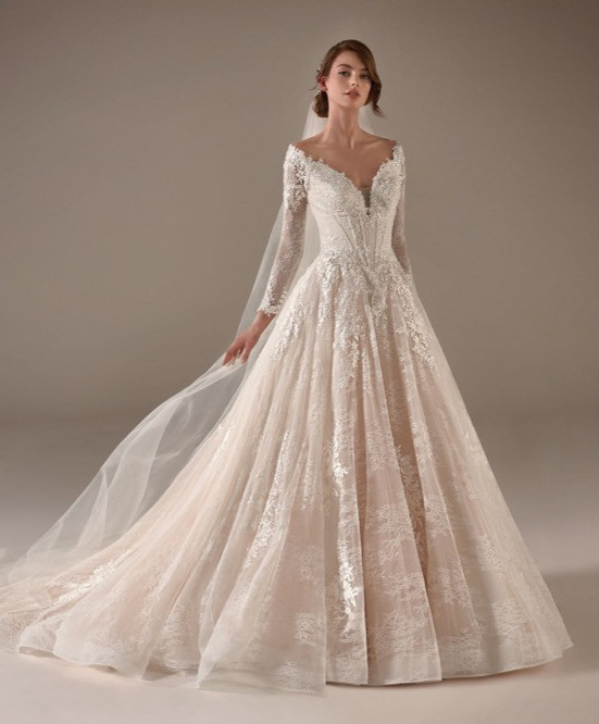 An off the shoulder, lace, ball gown wedding dress, with long sleeves and a corset top