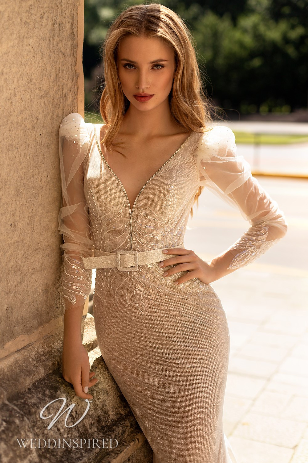A WONÁ Concept 2021 champagne mermaid wedding dress with long sleeves