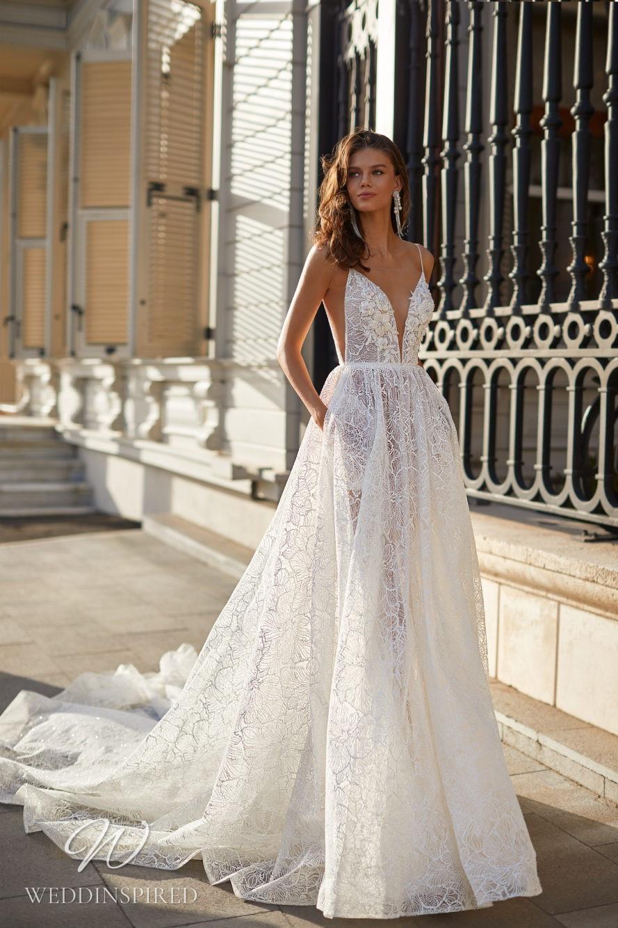 A Milla Nova 2021 lace A-line wedding dress with pockets, straps and a v neck