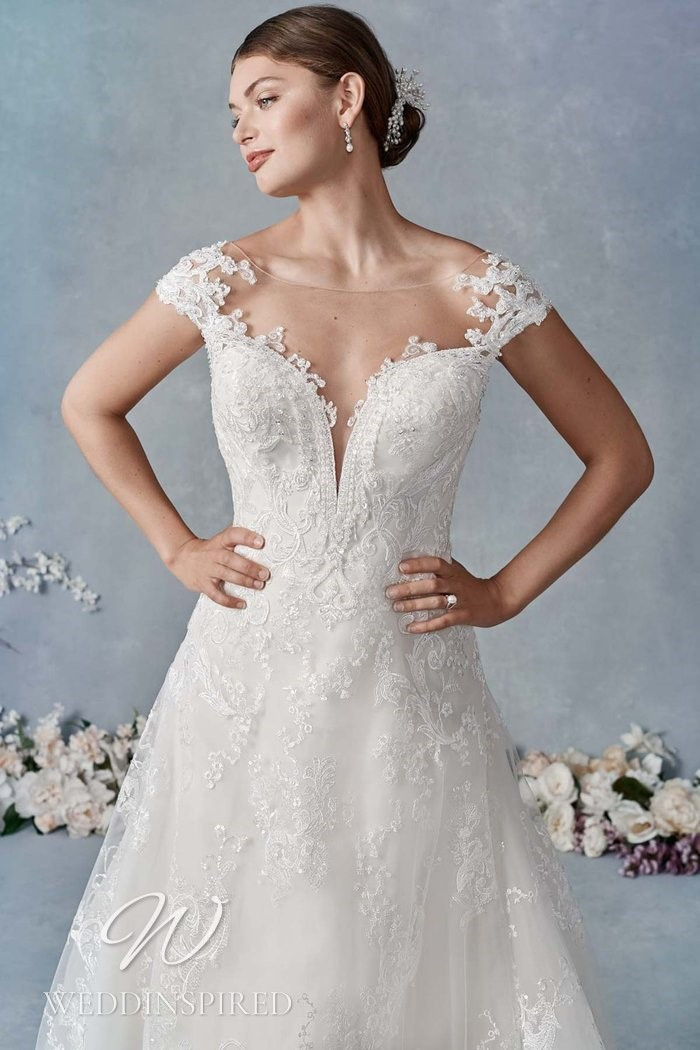 A Kenneth Winston 2021 lace off the shoulder A-line wedding dress
