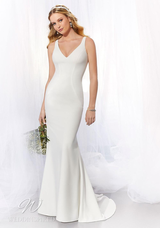A Madeline Gardner simple satin mermaid wedding dress