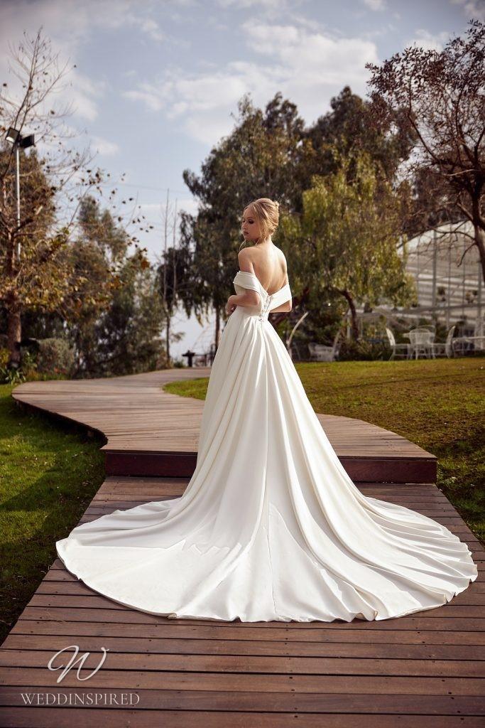 A Julie Vino 2021 simple strapless silk off the shoulder A-line wedding dress with a belt