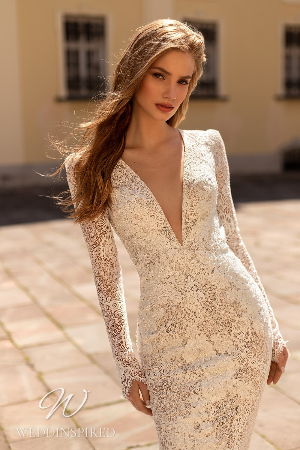 A WONÁ Concept 2021 lace mermaid wedding dress with long sleeves and a v neck