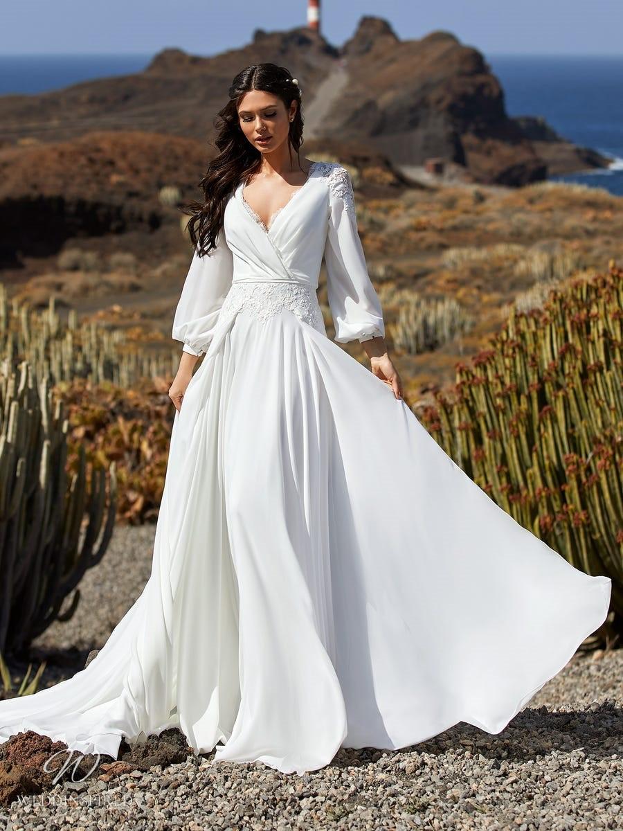 A Pronovias 2021 boho flowy A-line wedding dress with long sleeves