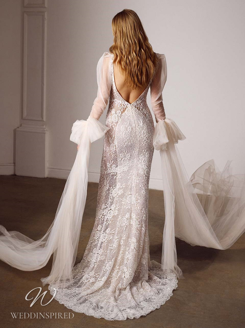 A Galia Lahav 2022 lace mermaid wedding dress with a low back and long sleeves