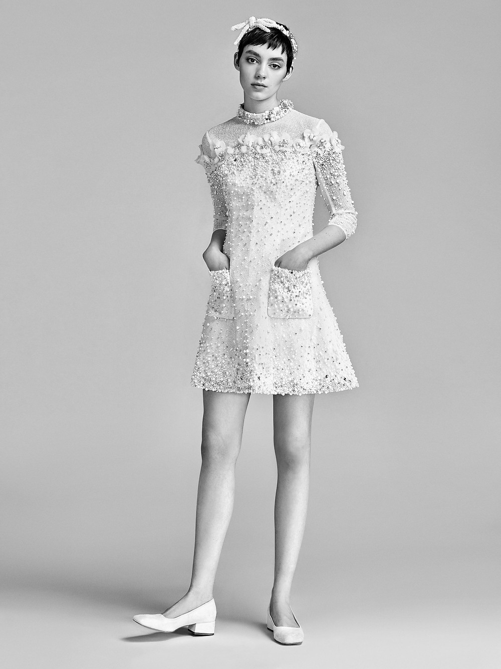 A Viktor & Rolf short beaded wedding dress with long sleeves