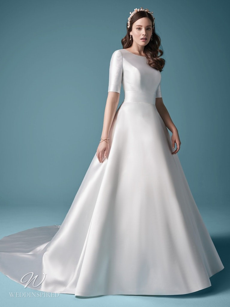A Maggie Sottero 2021 simple modest silk ball gown wedding dress with a high neck and sleeves