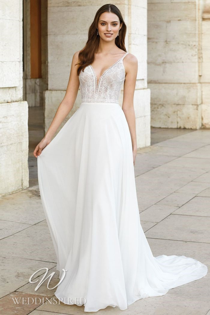 A Justin Alexander 2021 lace and chiffon A-line wedding dress with a v neck