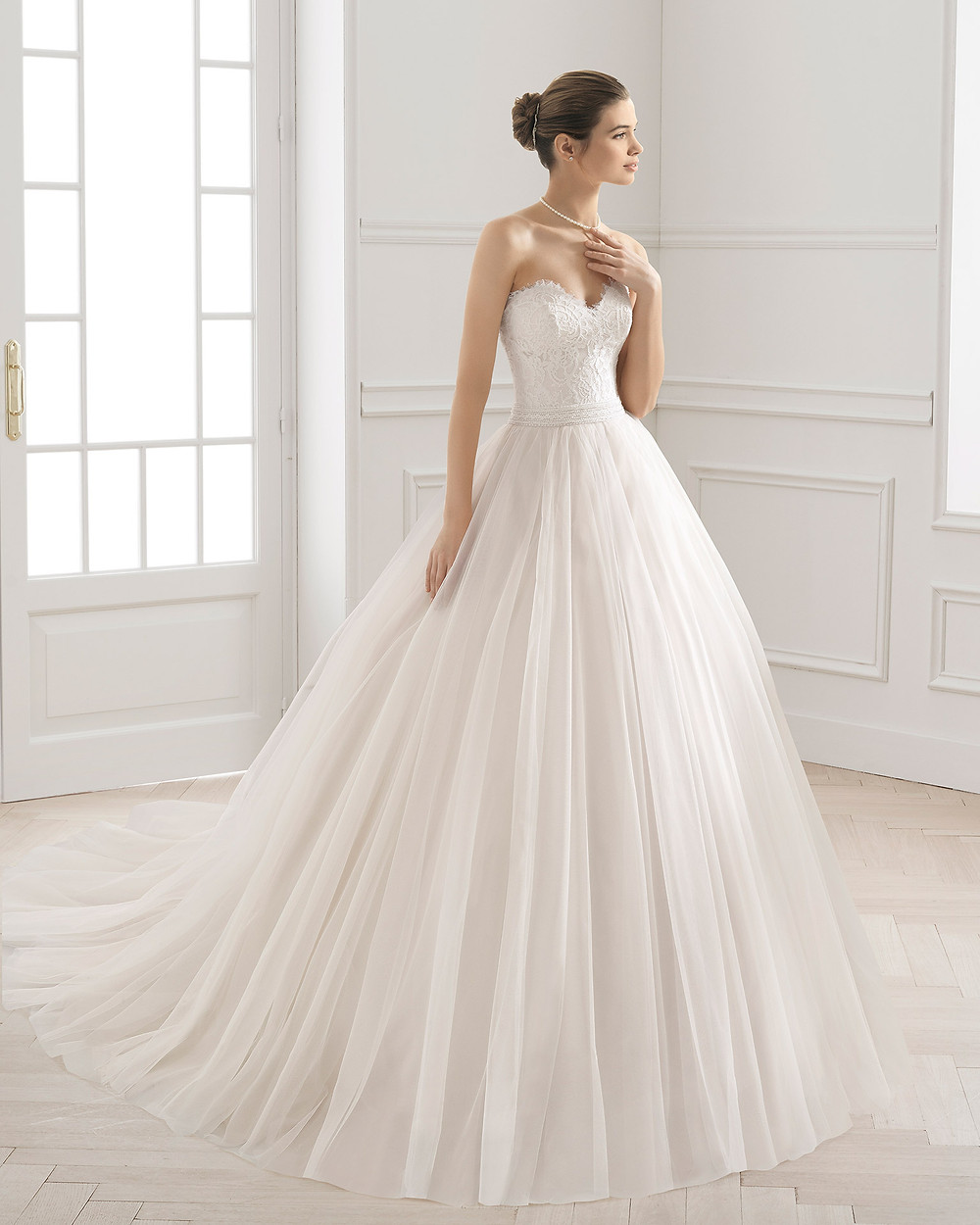 An Aire Barcelona 2020 strapless romantic lace and tulle ball gown wedding dress