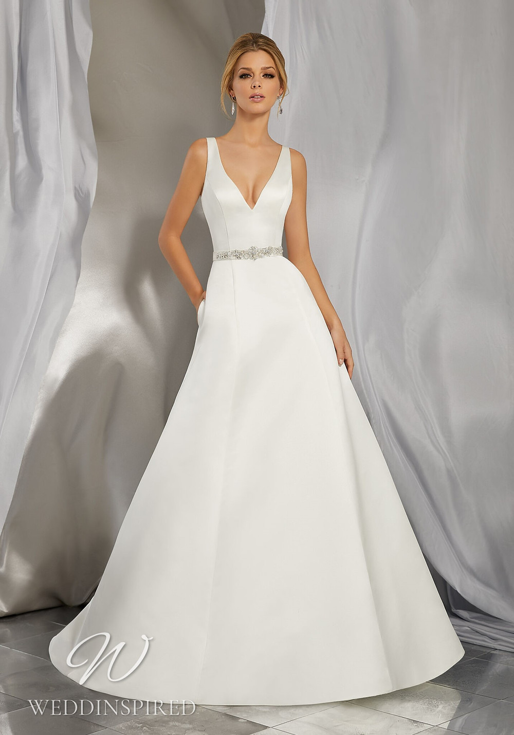 A Madeline Gardner simple satin A-line wedding dress with pockets