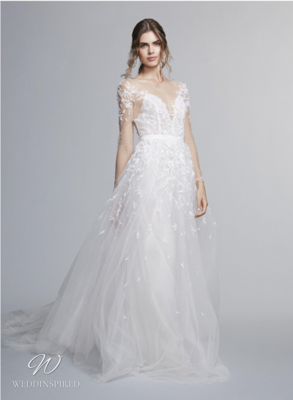 A Marchesa Notte Fall 2021 lace and tulle A-line wedding dress with long sleeves and a v neck