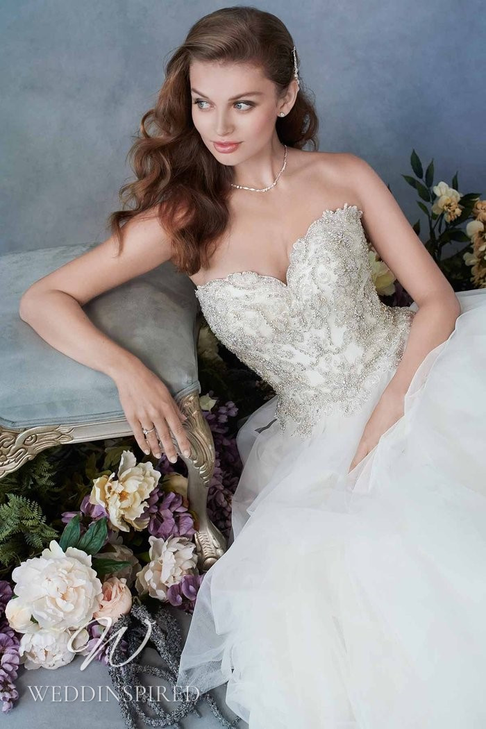 A Kenneth Winston 2021 strapless lace and tulle princess wedding dress