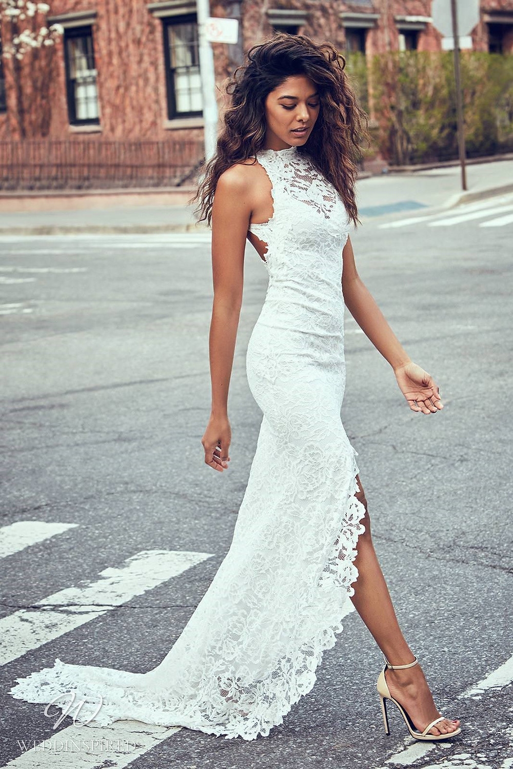 A Grace Loves Lace mermaid lace wedding dress with a high slit and a halterneck