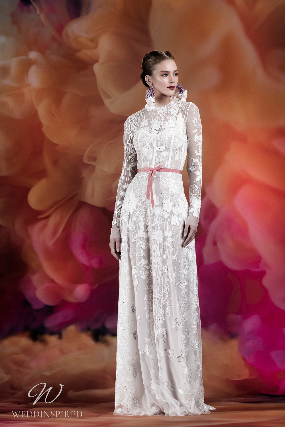 A Naeem Khan lace A-line wedding dress with illusion sleeves and a bustier top