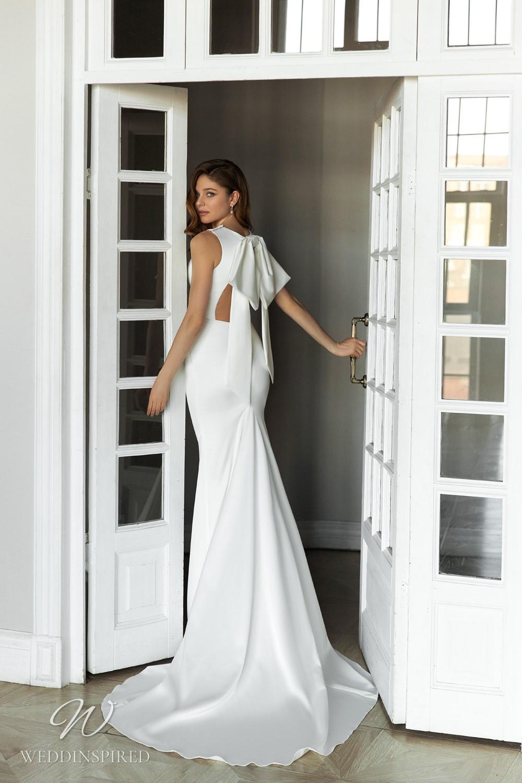 An Eva Lendel 2021 simple silk mermaid wedding dress with a big bow