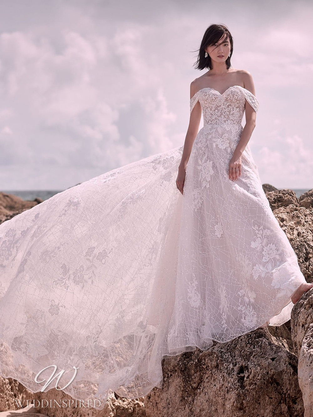 A Sottero & Midgley Spring 2021 off the shoulder lace and mesh A-line wedding dress