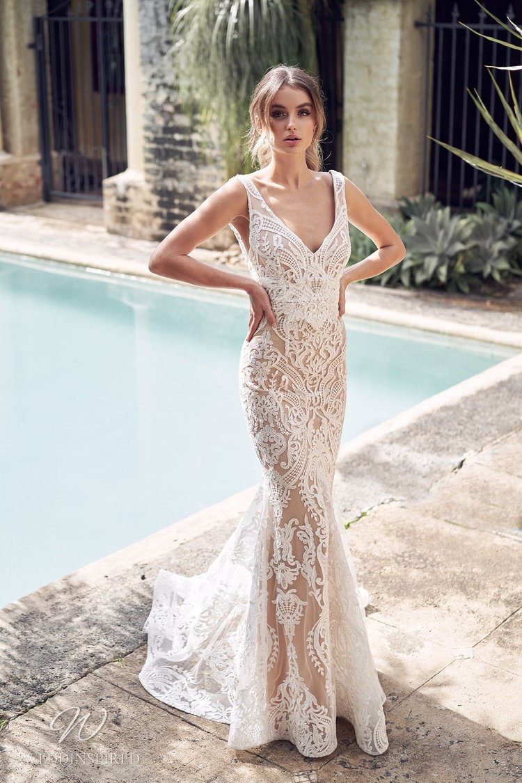 An Anna Campbell 2020 dark beige mermaid wedding dress with ivory lace and a v neck