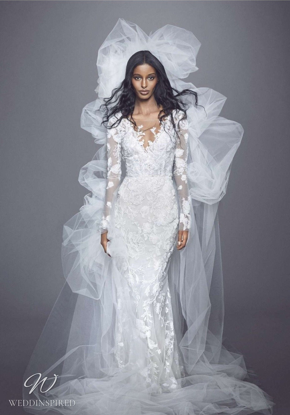 A Marchesa Fall 2021 lace mermaid wedding dress with long illusion sleeves and a v neck