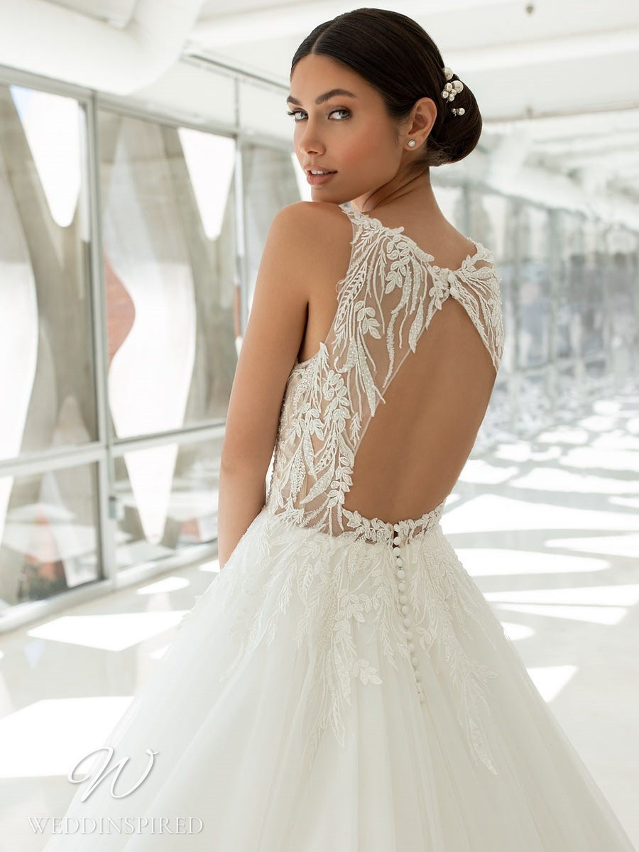 A Pronovias 2021 lace and tulle princess ball gown wedding dress with a keyhole back