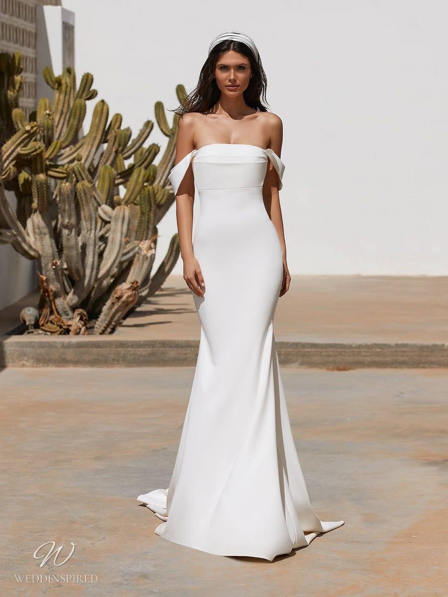 A Pronovias 2021 simple off the shoulder mermaid wedding dress