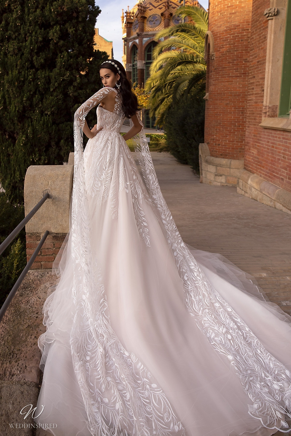 A Maks Mariano sparkle mesh and tulle princess ball gown wedding dress with long sleeves