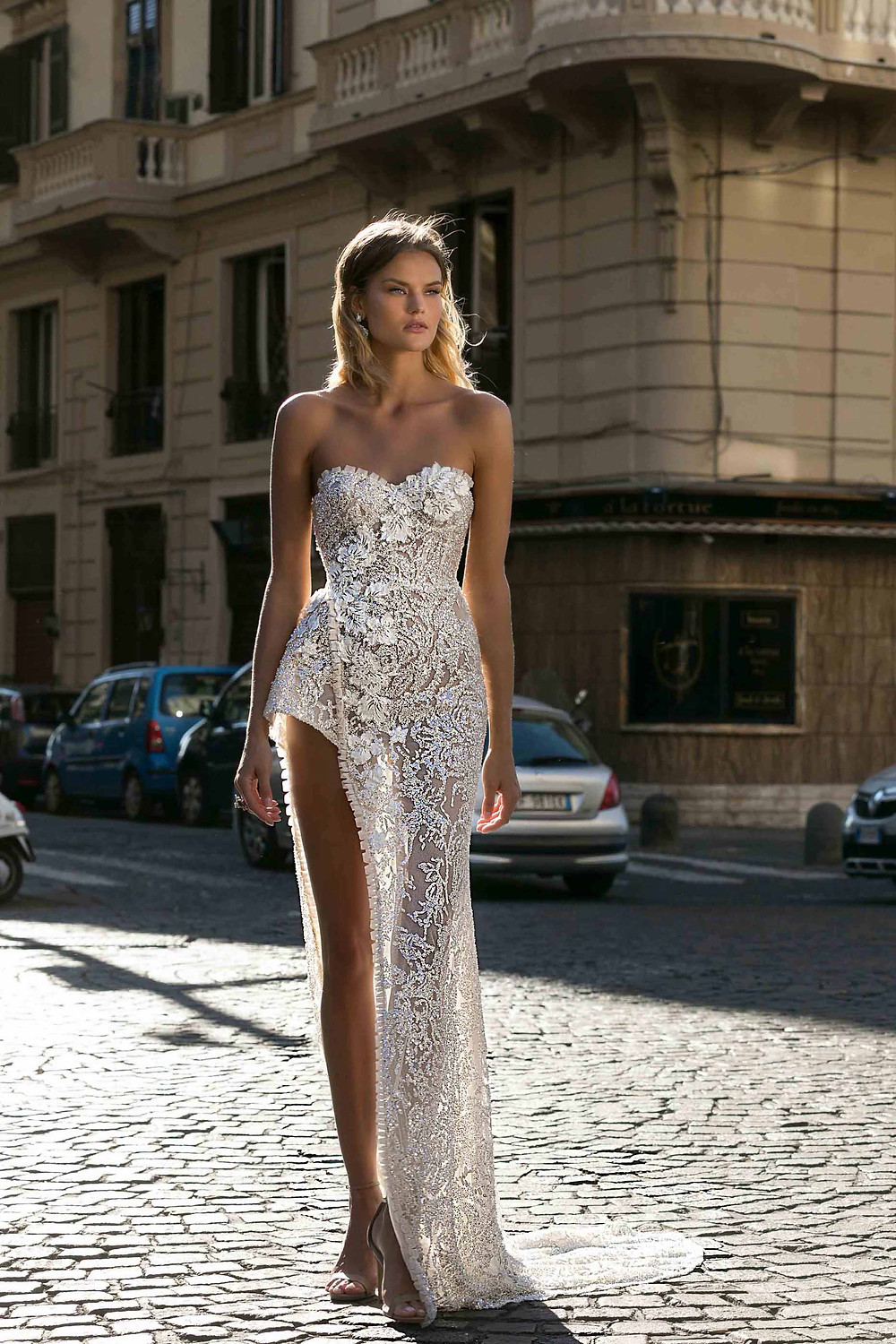 A sparkly silver short lace wedding dress, with sweetheart neckline