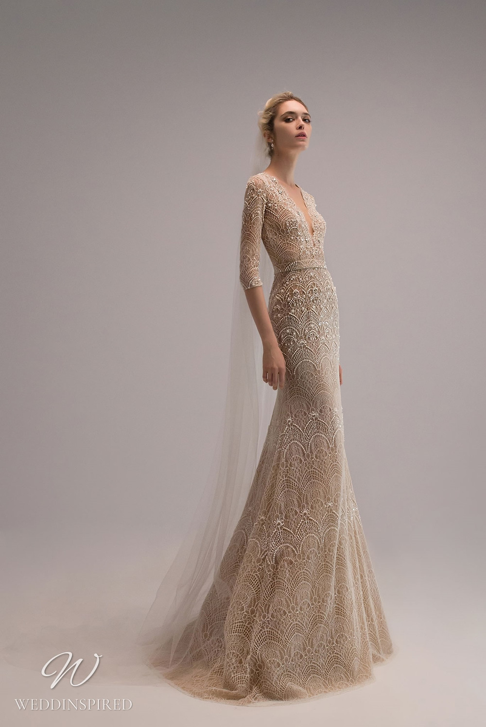 An Ersa Atelier 2021 blush lace mermaid wedding dress with half sleeves, a v neck and beading