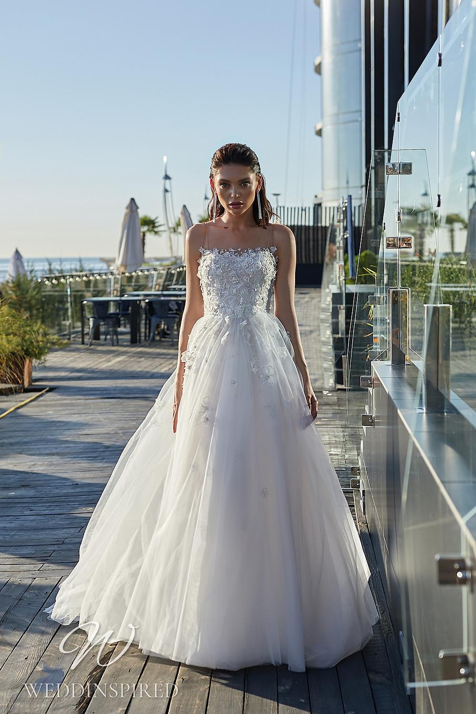An Ida Torez 2021 strapless lace and tulle princess wedding dress