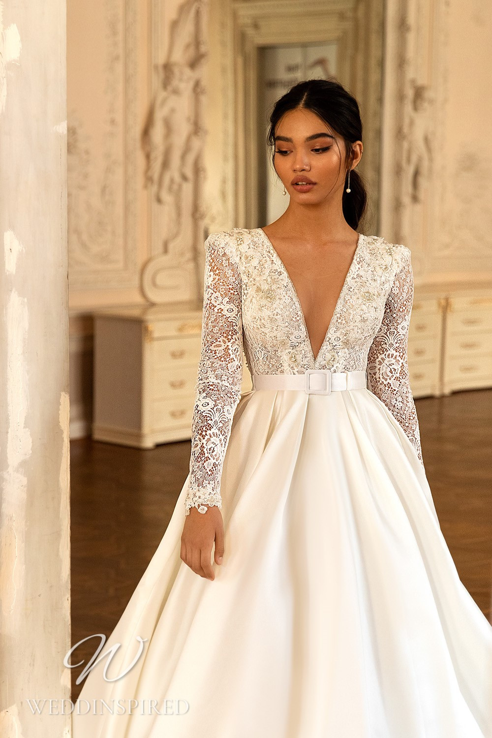 A WONÁ Concept 2021 lace and satin princess wedding dress with long sleeves