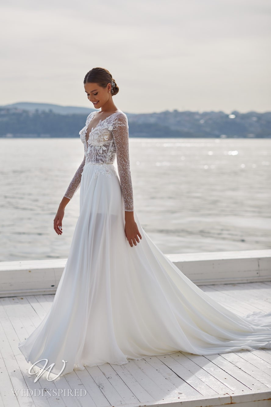 A Milla Nova 2021 sparkly chiffon and lace A-line wedding dress with long sleeves and a v neck
