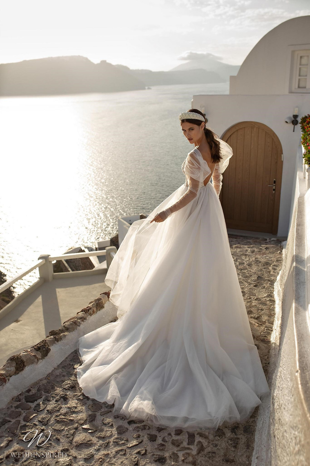 A Ricca Sposa gauzy tulle A-line wedding dress with long tulle sleeves