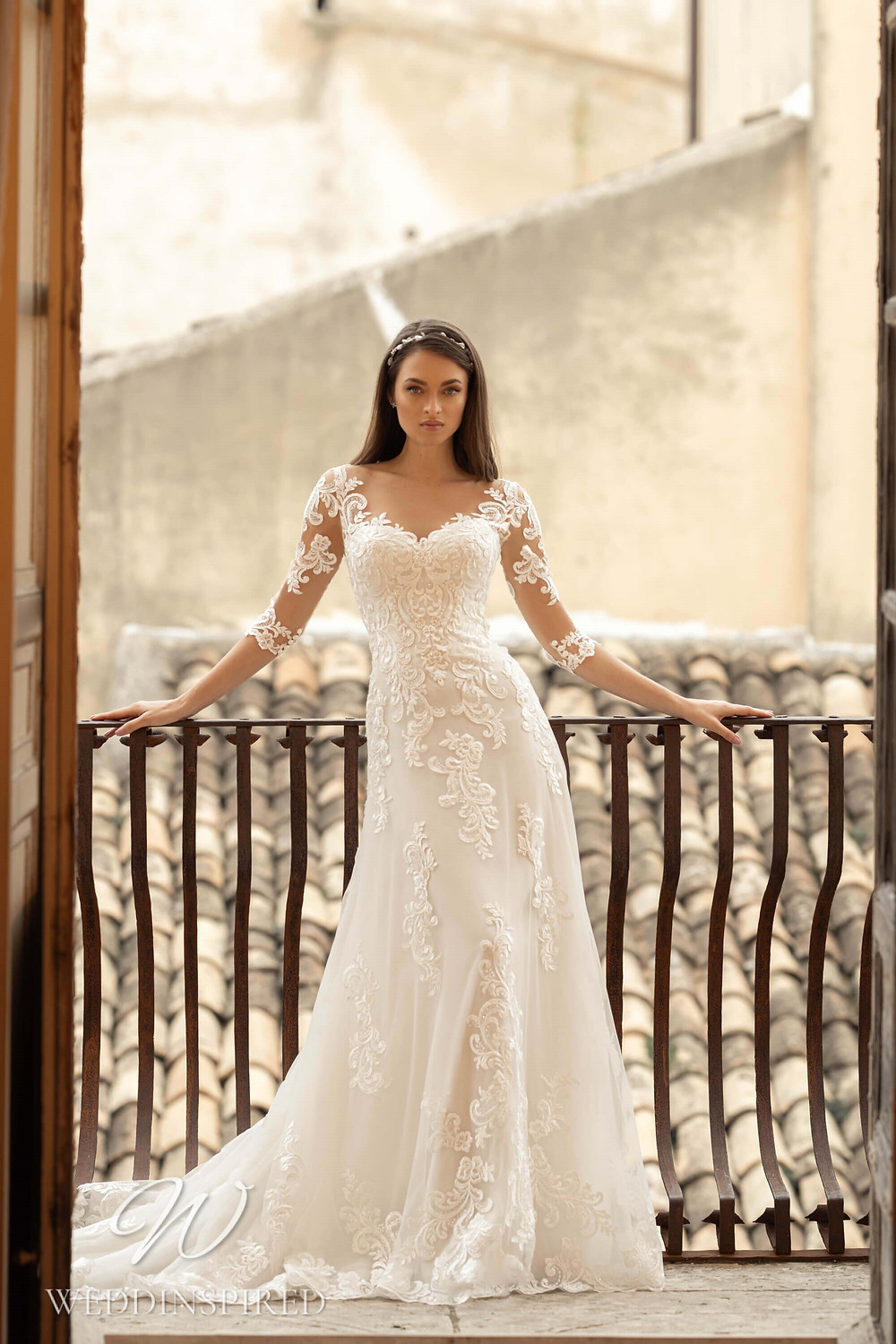 A Lussano 2021 lace A-line wedding dress with half sleeves