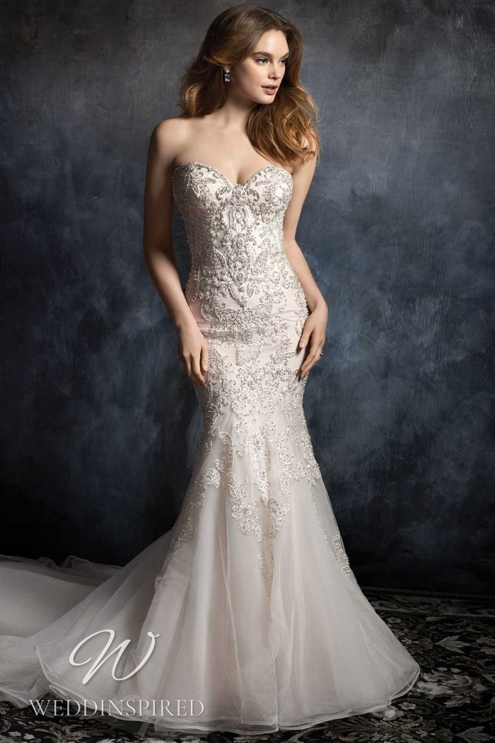 A Kenneth Winston 2021 satin and tulle strapless mermaid wedding dress