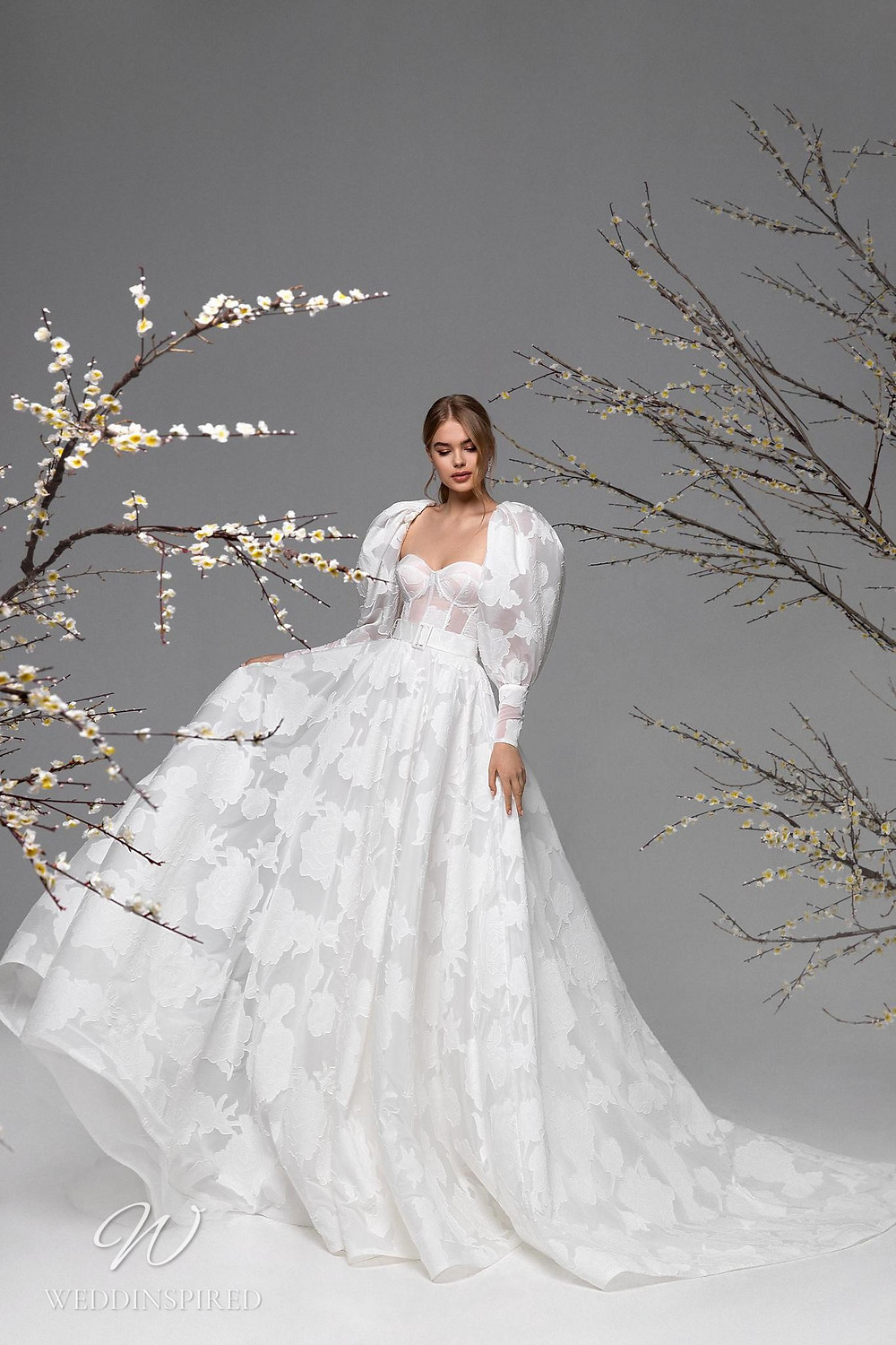 A Ricca Sposa print ball gown wedding dress with long puff sleeves