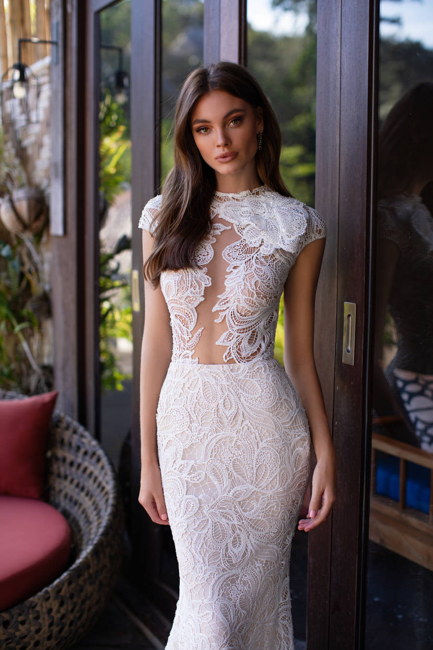 A Milla Nova sexy lace mermaid fit and flare wedding dress with cap sleeves