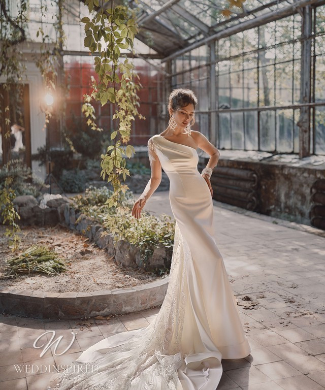 An Ange Etoiles 2021 silk and lace one shoulder mermaid wedding dress