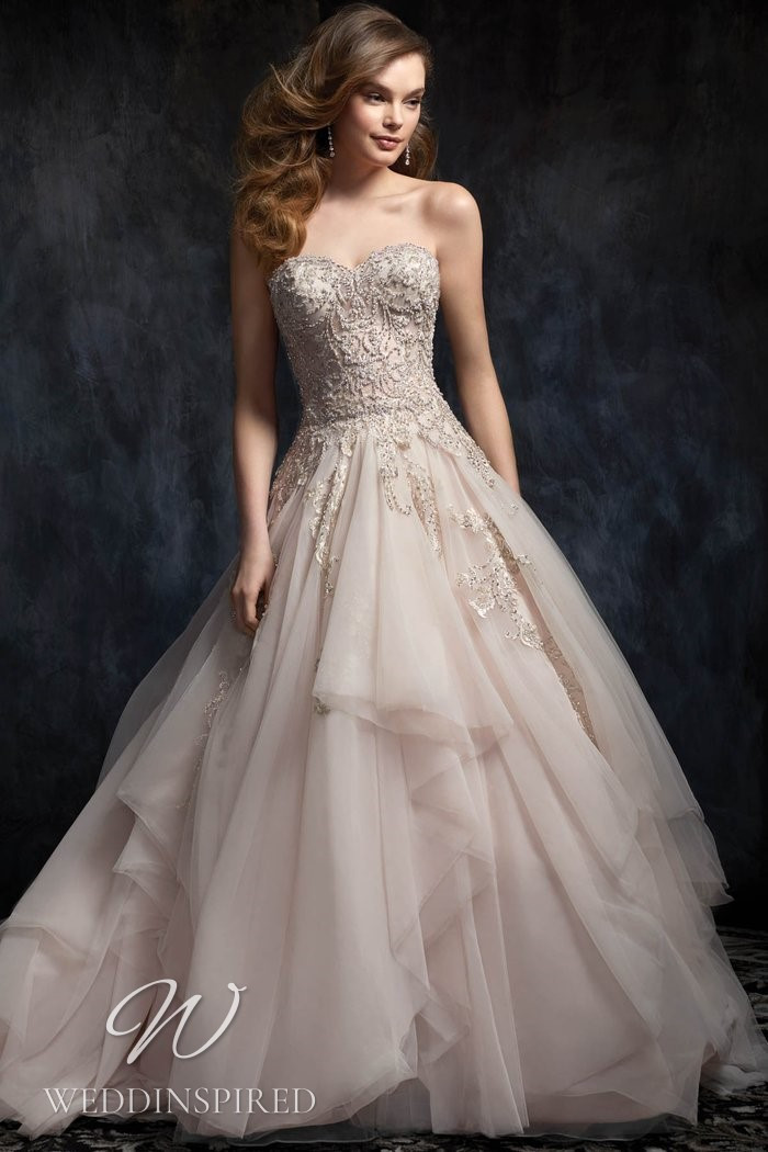 A Kenneth Winston 2021 blush lace and tulle strapless princess wedding dress