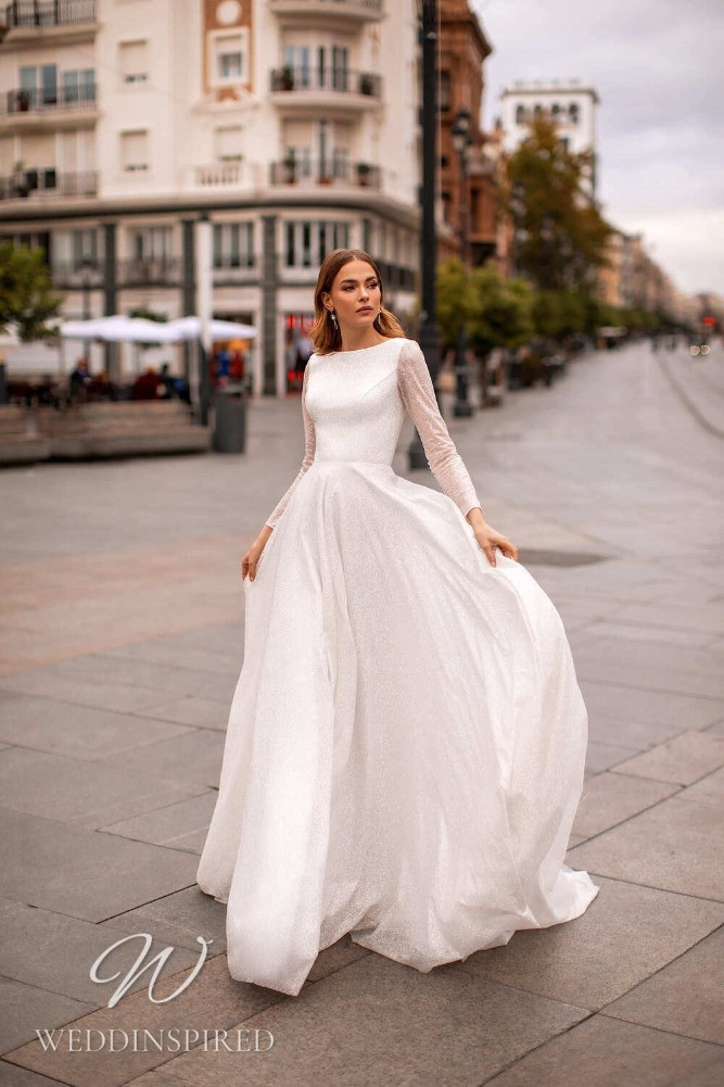 A Nora Naviano 2021 modest sparkly A-line wedding dress with long sleeves