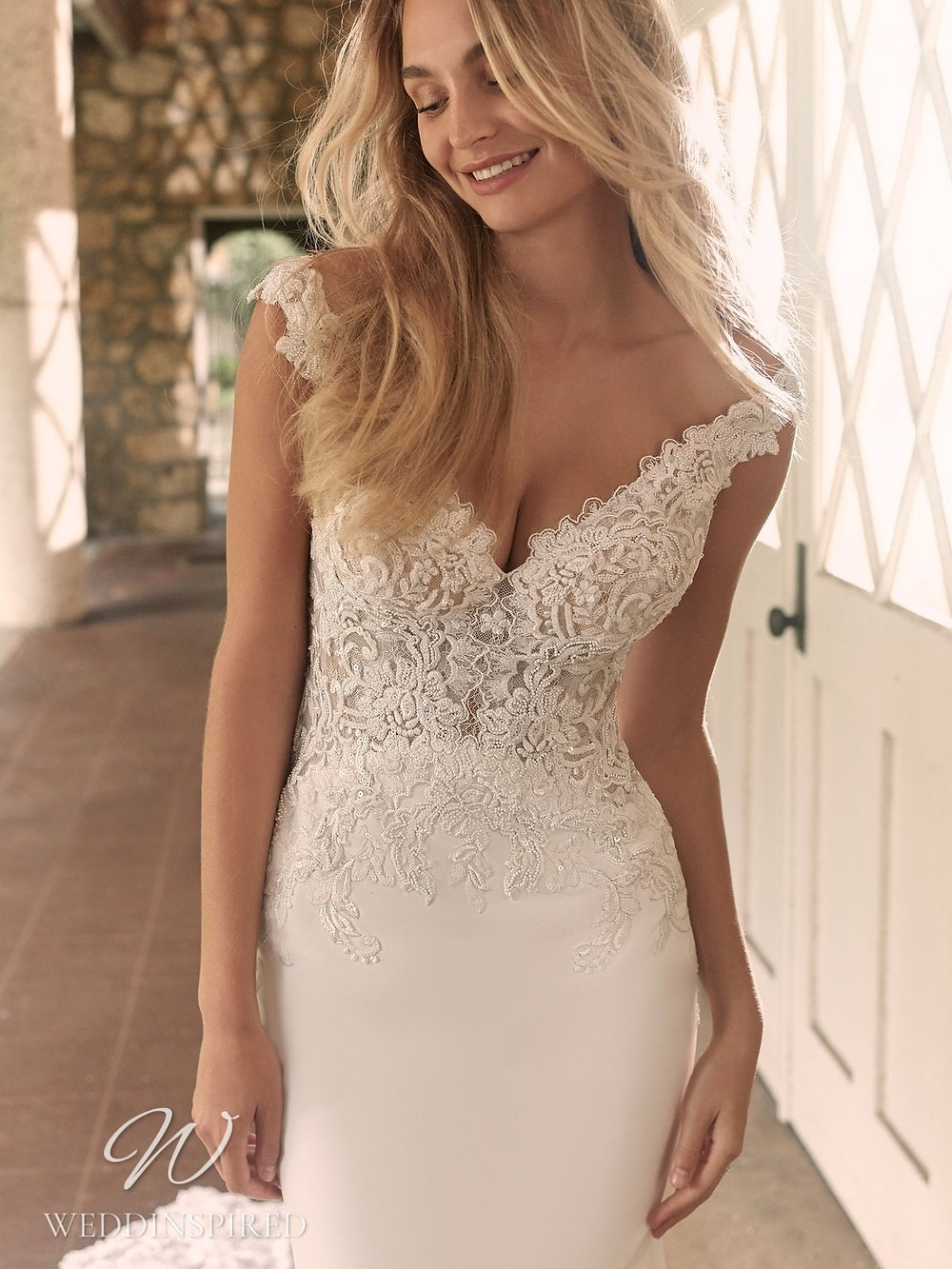 A Maggie Sottero Spring 2021 off the shoulder lace and crepe mermaid wedding dress with a v neck