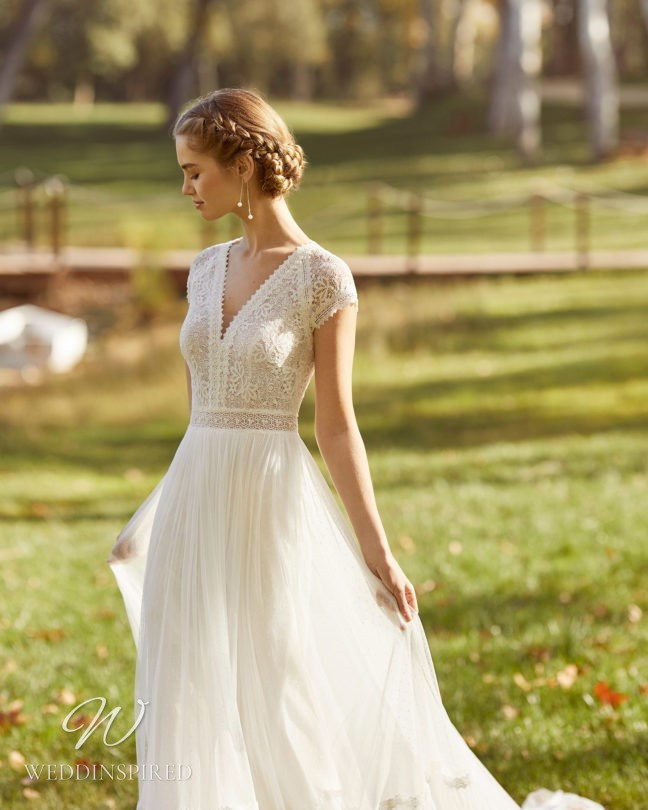 An Aire Barcelona 2021 lace and tulle boho A-line wedding dress with cap sleeves