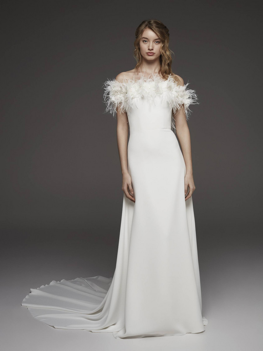 A Pronovias crepe and feather off the shoulder A-line wedding dress