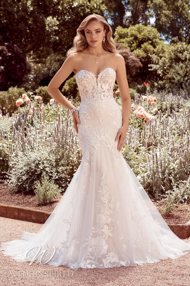 A Sophia Tolli 2021 strapless lace and tulle mermaid wedding dress