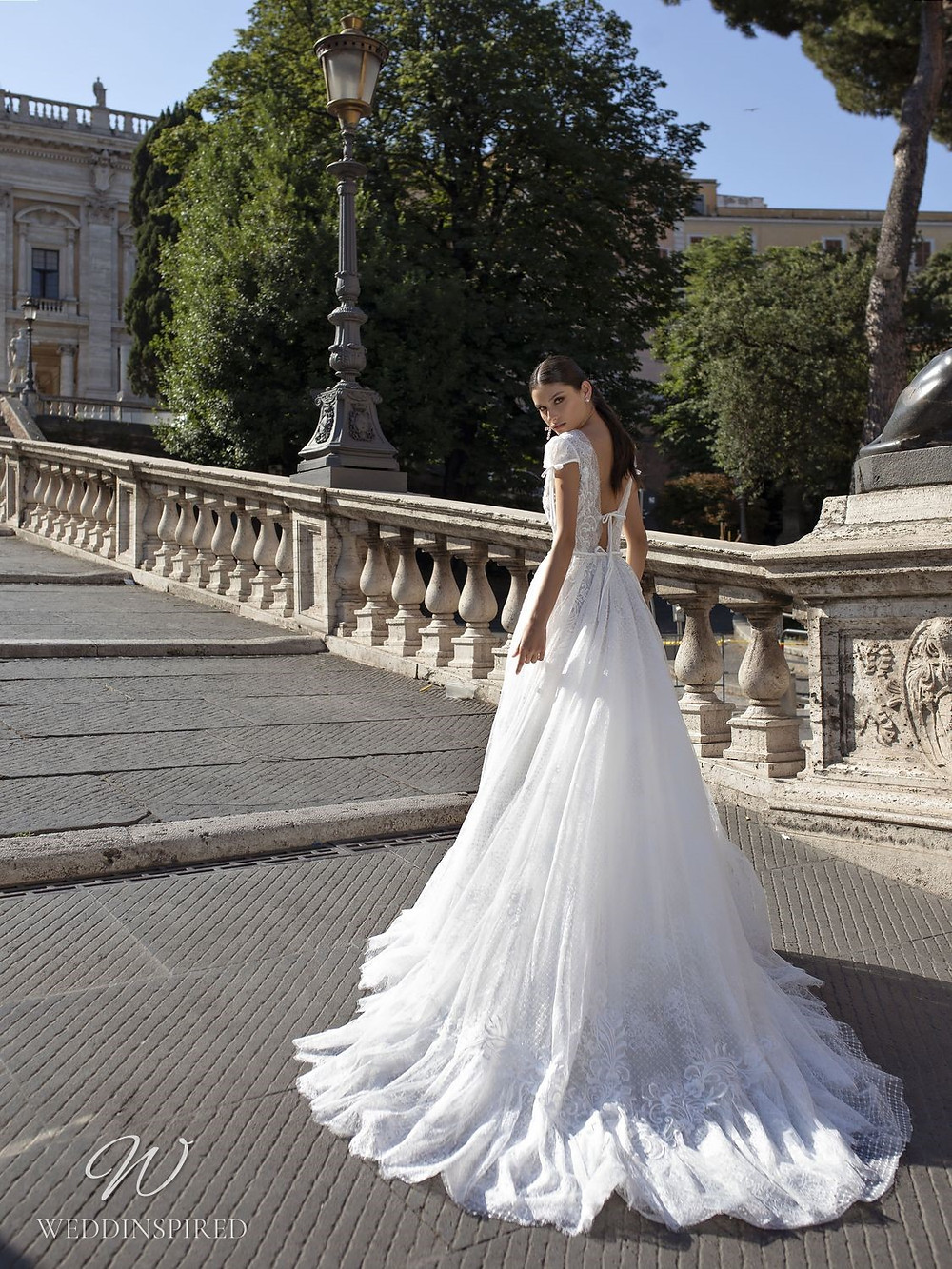 A Pinella Passaro lace A-line wedding dress with a low back and cap sleeves
