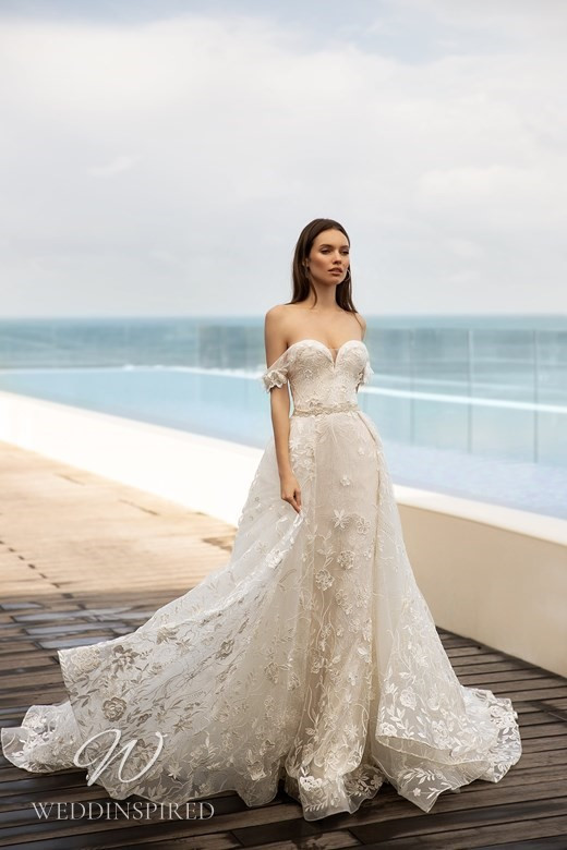 An Ida Torez 2021 ivory off the shoulder floral tulle ball gown wedding dress with a sweetheart neckline