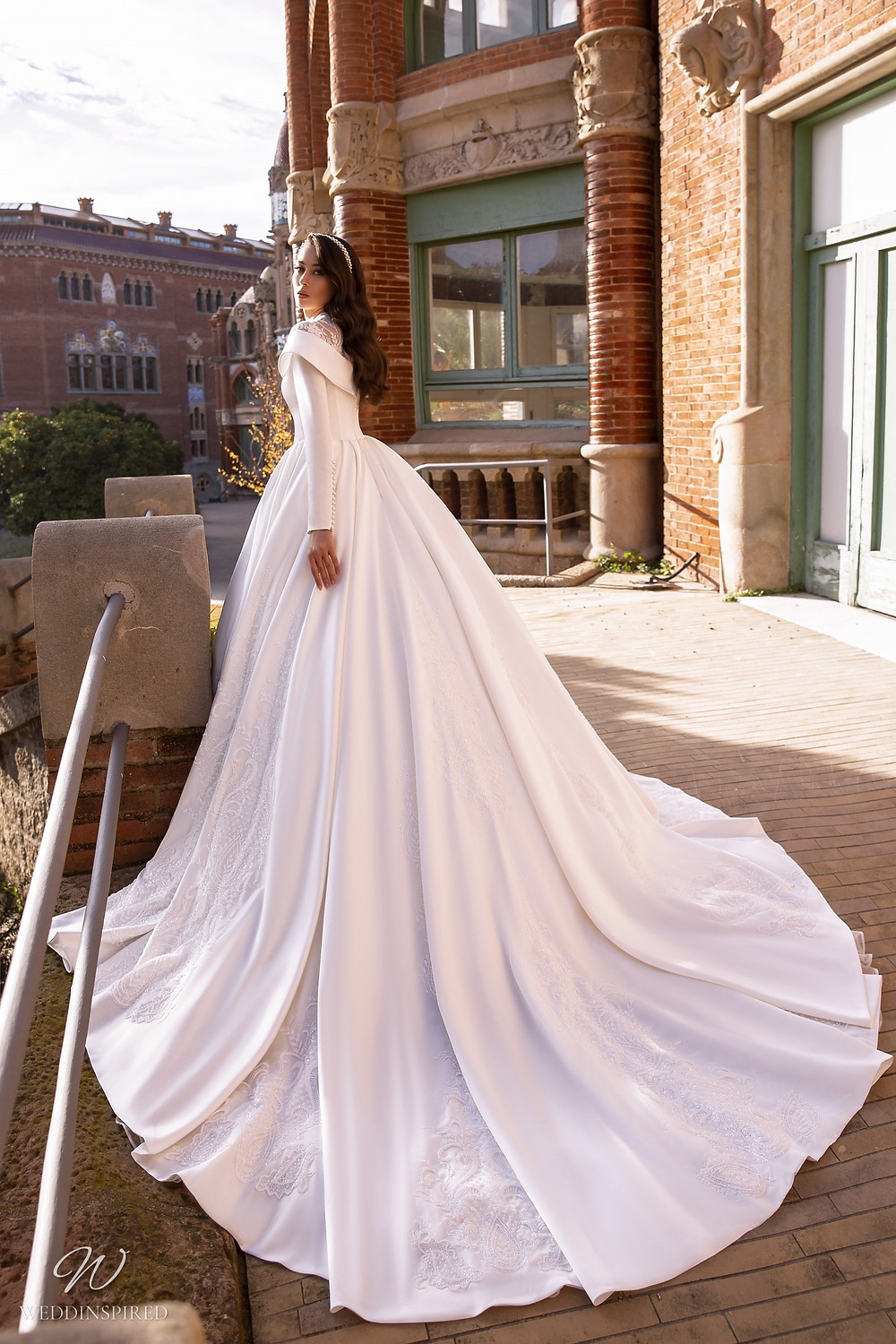 A Maks Mariano off the shoulder princess ball gown wedding dress with long sleeves