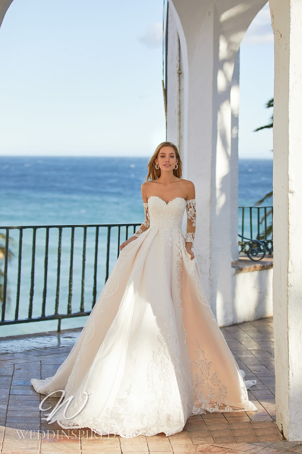 An Essential by Lussano 2021 blush strapless lace princess wedding dress